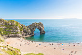Pranoramic view of Durdle Door and seaside. Famous rock arch in the Jurassic coast, Dorset, England. Tourism and nature concepts in this postcard view.