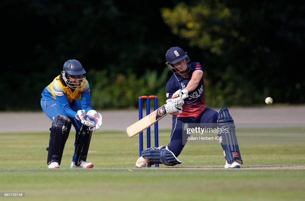Prasadani Weerakkodi of Sri Lanka looks on as Katherine Brunt of England hits out during The ICC Women's World Cup warm up match between England and Sri Lanka at Queens Park on June 19, 2017 in Chesterfield, England.