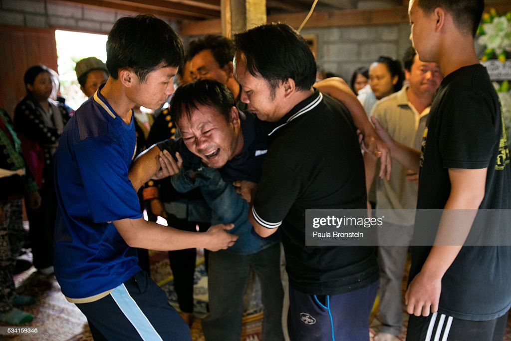 Prasert Teud Prai Panawan, grieves the loss of his daughter Chomphu, age 8, during a memorial service in the Hmong community of Jom Thong, Chiang Mai province May 25, 2016. A tragic fire broke out on Sunday night killing at least 17 girls at the Pitakkiat Wittaya school, home to pupils from impoverished local hill tribes in the region, they were aged between 5 to 13. Based on reports, many of the 38 students were asleep when the fire swept through the elementary school in Chiang Rai Province and investigations are still being carried out to find the cause of the fire.