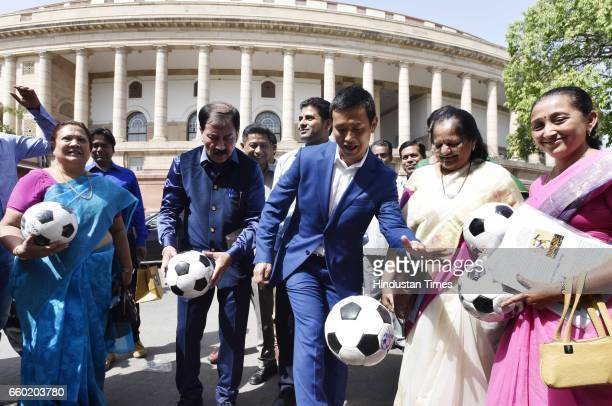 Prasun Banerjee MP with Bhaichung Bhutia and other Members of Parliament playing football after Lok Sabha Speaker Sumitra Mahajan presented footballs...