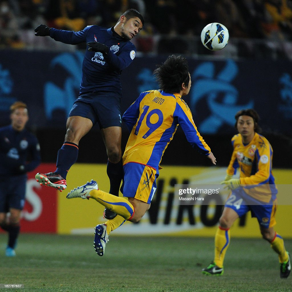 Prathum Chutong #3 of Buriram United (L) and Yuki Muto #19 of Vegalta Sendai compete for the ball during the AFC Champions League Group E match between Vegalta Sendai and Buriram United at Sendai Stadium on February 26, 2013 in Sendai, Japan.