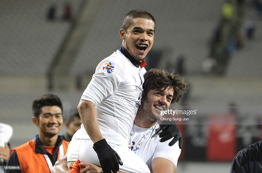 Prathum Chutong of Buriram United celebrates after advanced to the round of 16 after the AFC Champions League Group E match between FC Seoul and Buriram United at Seoul World Cup Stadium on May 1, 2013 in Seoul, South Korea.