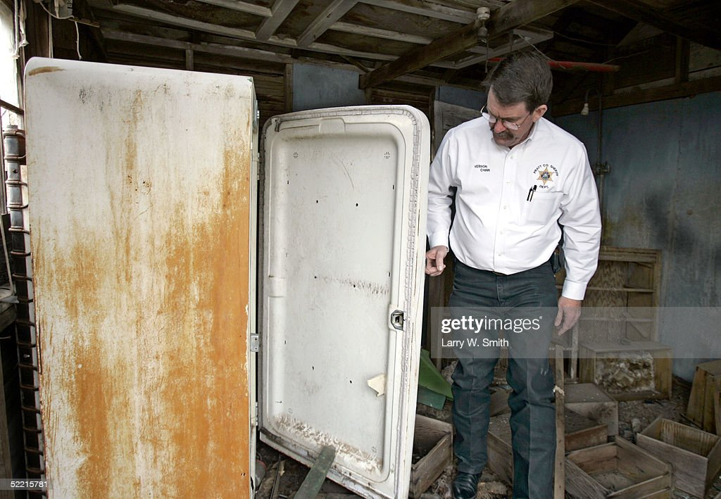 Pratt County Sheriff Vernon Chinn looks inside old refrigerator in an abandoned barn on Febuary 18, 2005 for left over items used in the production of methamphetamine while he patrols the rural areas near Pratt, Kansas. The Pratt County Sheriff's Office has over 700 square acres of rural land to patrol on a daily basis looking for any kind of methamphetamine substances such as trash or labs.