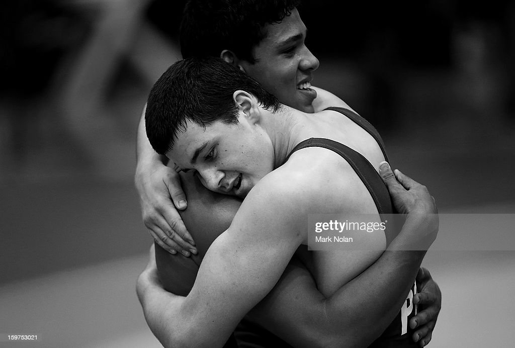 C Pratt of Australia (Right) and Guilherme Dias of Brazil embrace during the Wrestling competes on day five of the Australian Youth Olympic Festival at Sydney Olympic Park Sports Halls on January 20, 2013 in Sydney, Australia.
