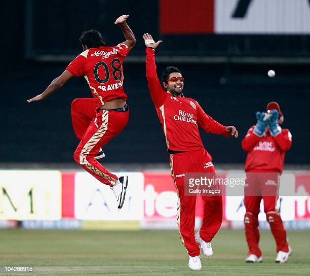 Praveen Kumar celebrates his wicket of Sachin Tendulkar of the Mumbai Indians with Virat Kohli of the Royal Challengers Bangalore during the Airtel...