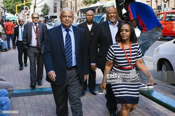 Pravin Gordhan South Africa's finance minister center arrives at the North Gauteng High Court for a hearing in Pretoria South Africa on Tuesday March...