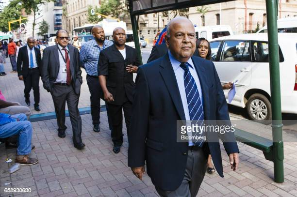 Pravin Gordhan South Africa's finance minister right arrives at the North Gauteng High Court for a hearing in Pretoria South Africa on Tuesday March...