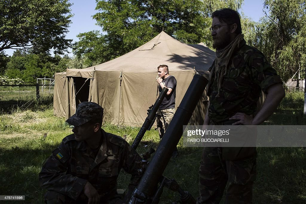 Praviy Sektor fighters train at their headquarter in a small village near Pokrovskoe eastern Ukraine on June 3 2015 Right Sector is a paramilitary...