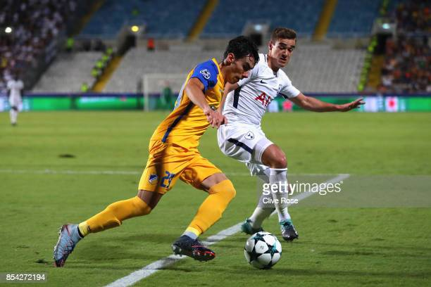 Praxitelis Vouros of of Apoel FC and Harry Winks of Tottenham Hotspur battle for possession during the UEFA Champions League Group H match between...