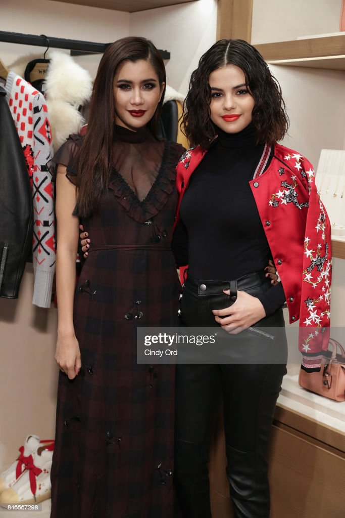 Praya Lundberg (L) and Selena Gomez pose during the Coach In-Store Event with Selena Gomez at Coach Boutique on September 13, 2017 in New York City.