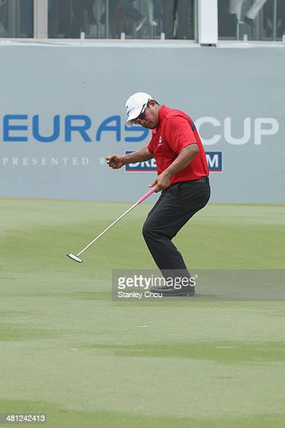 Prayad Marksaeng of Team Asia reacts on the 18th hole during the singles draw matches against Team Europe during day three of the EurAsia Cup at...