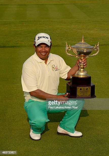 Prayad Marksaeng of Thailand oictured with the winner's trophy during Round 4 of the 2014 King Cup Golf Hua Hin at Black Mountain Golf Club on...