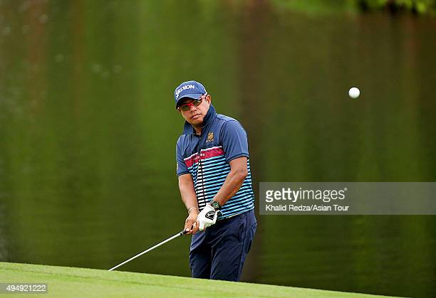 Prayad Marksaeng of Thailand plays a shot during round two of the CIMB Classic at Kuala Lumpur Golf Country Club on October 30 2015 in Kuala Lumpur...