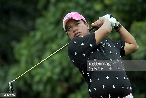 Prayad Marksaeng of Thailand watches his tee shot on the 8th hole during the Final Round of the Barclays Singapore Open held at the Sentosa Golf Club...