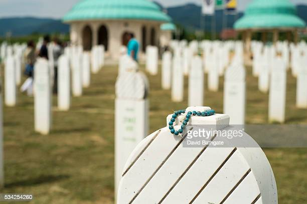 Prayer beads adorn a Muslim grave in the cemetery at Kozarac Bosnia and Herzegovina The cemetery contains many victims of Serb Military aggression in...