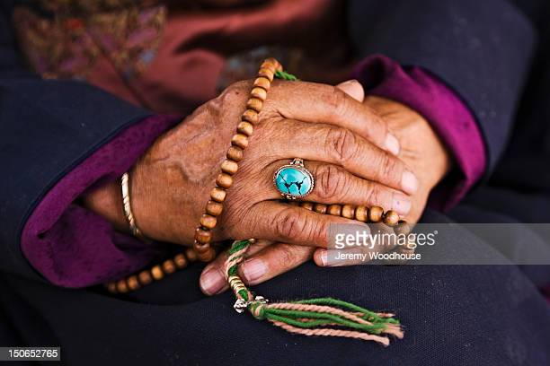 Prayer beads in a woman's hands