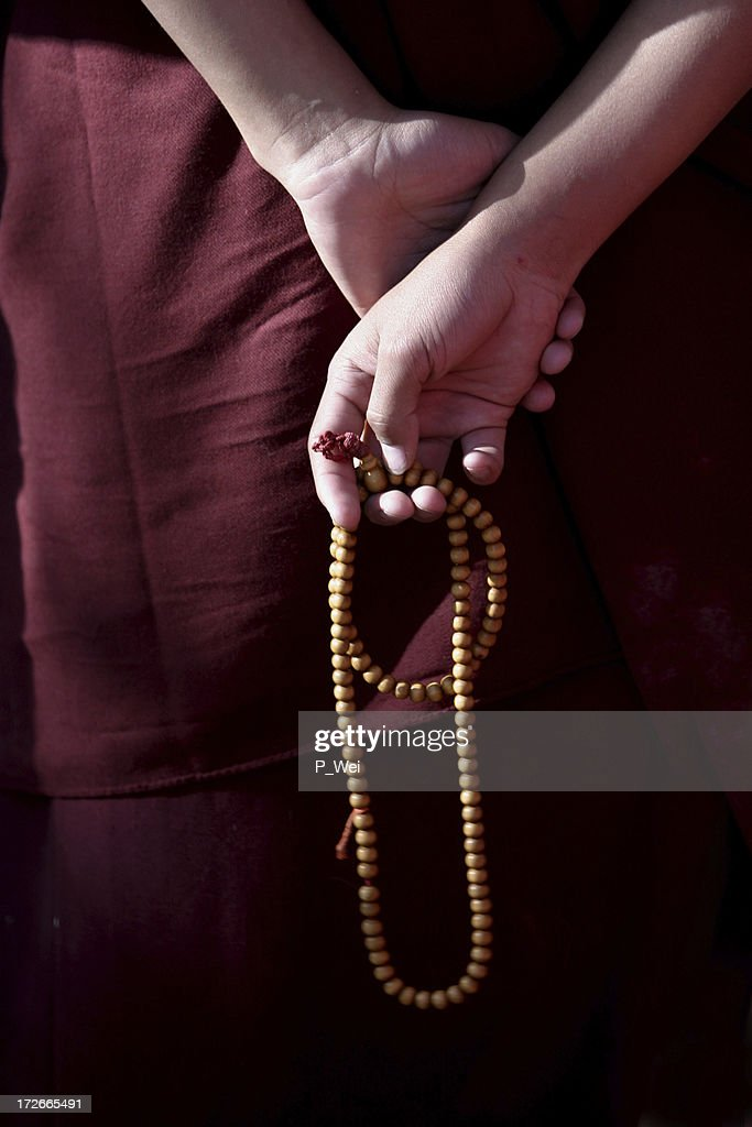 Prayer Beads in the hands of a monk