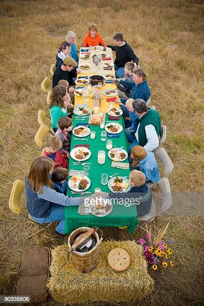 prayer before outdoor Fall dinner