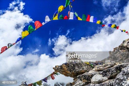 Prayer flags and Mani stone
