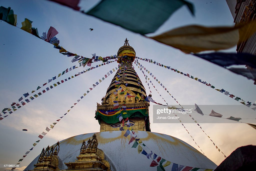 Prayer flags in front of the white dome of the Bodhnath Stupa the largest Stupa in Nepal and one of the largest in the world