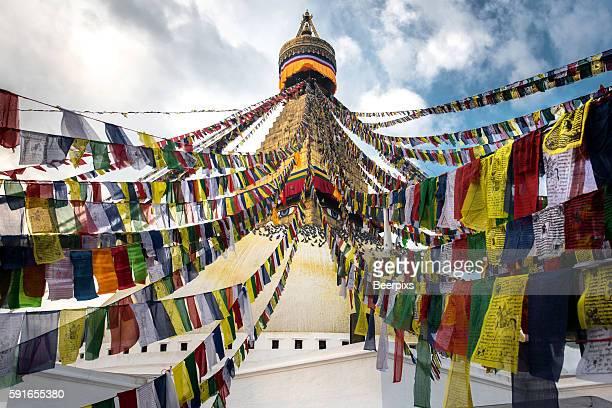 Prayer flags with the Boudhanath Stupa in Kathmandu, Nepal.