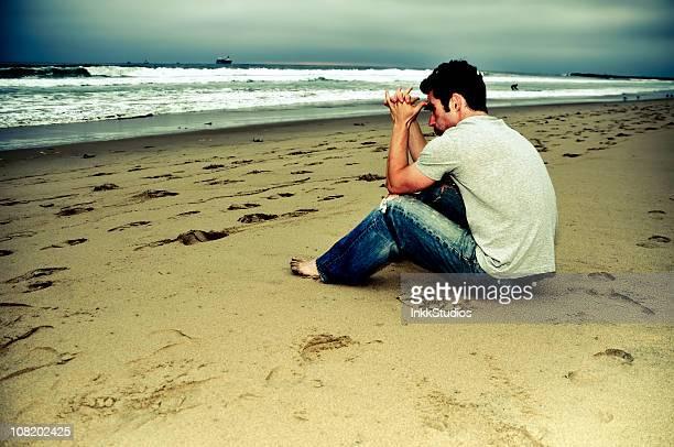 Preghiera sulla spiaggia