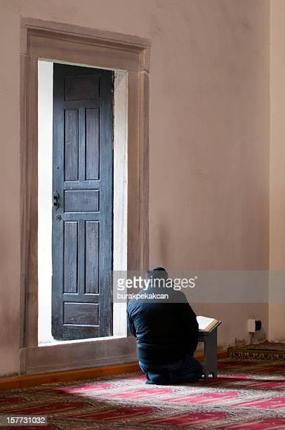 Prayer reading Koran in Atik Ali Pasha Mosque, Istanbul, Turkey