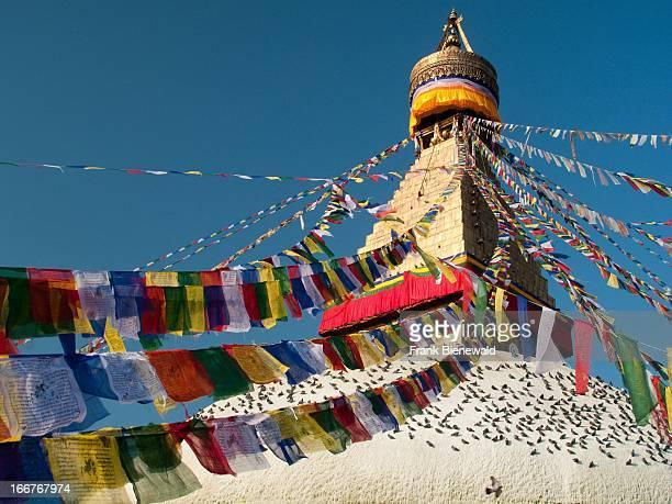 Prayerflags surrounding the top of BoudnathStupa