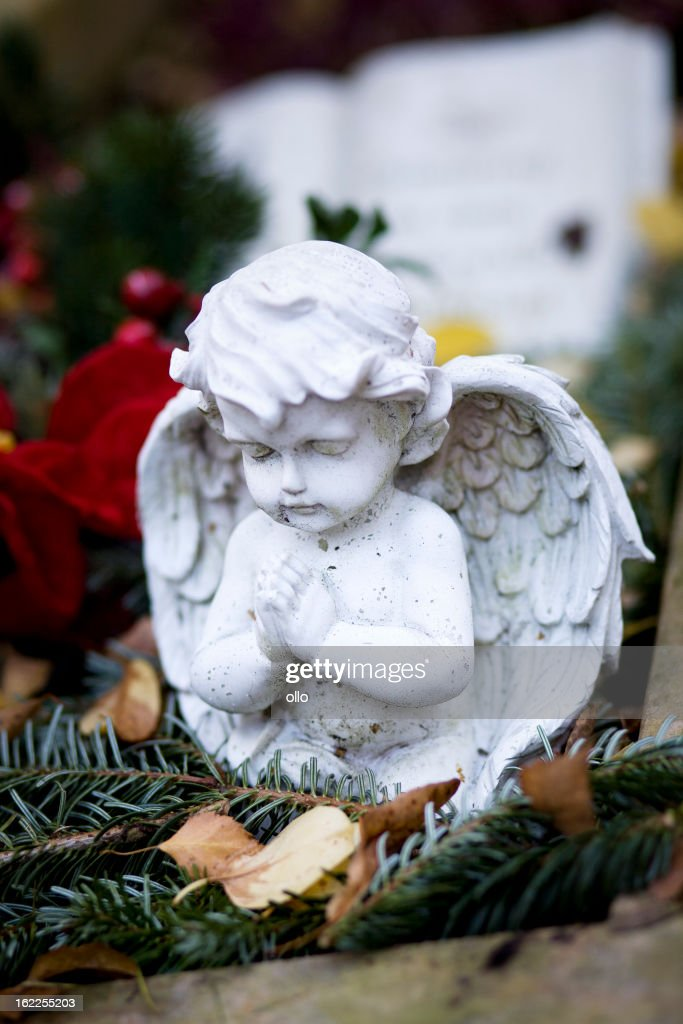 Praying angel on an old grave stock photo getty images for Praying angel plant