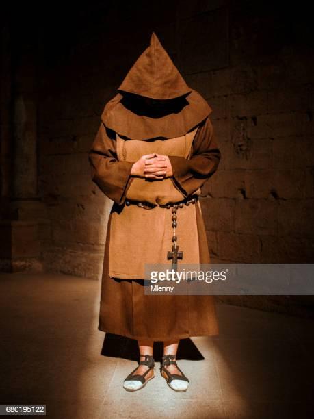 Praying Monk in Cathedral