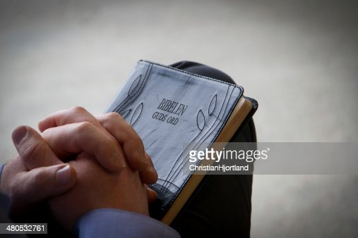 Praying over Bible : Stock Photo