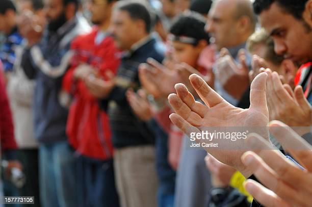 Praying people in Tahrir Square
