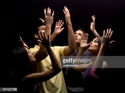 Praying together : Stock Photo