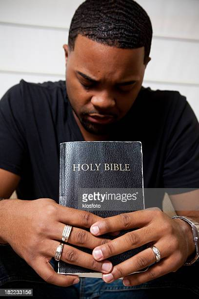 Praying while holding the Bible