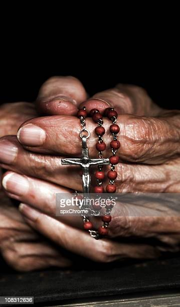 Praying with Rosary Beads