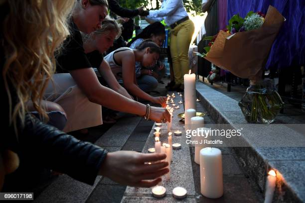 Prays are said and candles are lit outside Notting Hill Methodist Church near the 24 storey residential Grenfell Tower block in Latimer Road West...