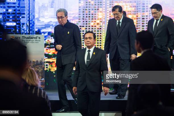 Prayuth ChanOcha Thailand's prime minister center and Somkid Jatusripitak Thailand's deputy prime minister left leave the stage during the Thailand's...