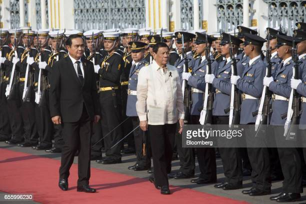 Prayuth ChanOcha Thailand's prime minister left walks alongside Rodrigo Duterte the Philippines' president ahead of a news conference at Government...