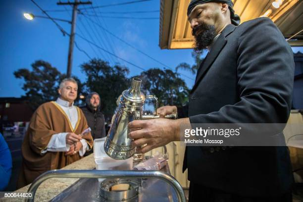 Pre dawn coffee for early arrivals as worshipers flock to the The Imam Ali Bin Abi Taleb Mosque or Lakemba Mosque in suburban Sydney Australia Crowds...