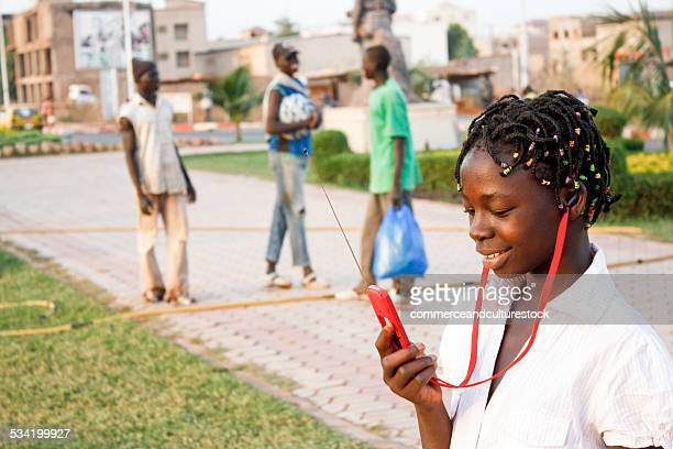 A pre teen girl using a mobile phone