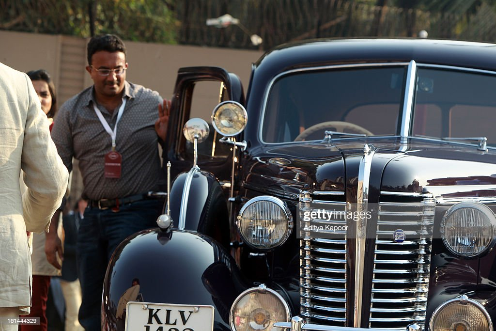 Pre War Classic Limouisine class winner Diljeet Titus with his 1938 Buick 90L limited at the Cartier 'Travel With Style' Concours 2013 at Taj Lands End on February 10, 2013 in Mumbai, India.