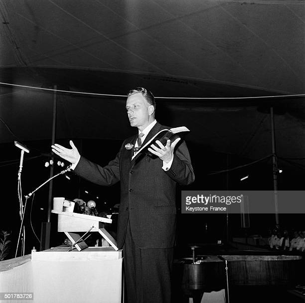Preacher Billy Graham holding the Holy Bible during speech during his stay in Paris in May 13 1963 in Paris Fance