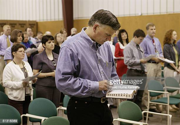 Preacher Franklin Graham reads his bible during a prayer service at his headquarters on June 6 2003 in Boone North Carolina