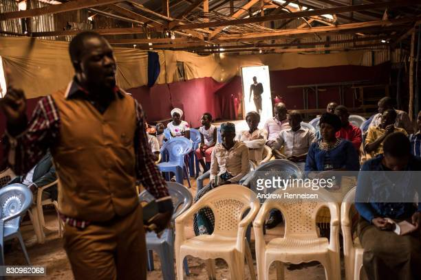 A preacher speaks during Sunday service at Fullgospel Evangelistic Ministry in the Kibera slum on August 13 2017 in Nairobi Kenya A day prior...