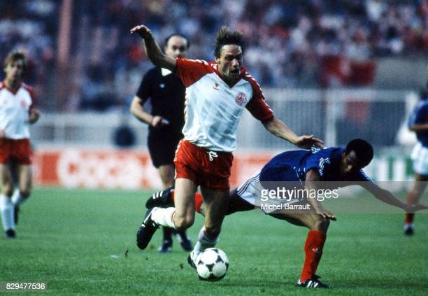 Preben Elkjaer Larsen of Denmark and Jean Tigana of Tigana during the European Championship match between France and Denmark at Parc des Princes...