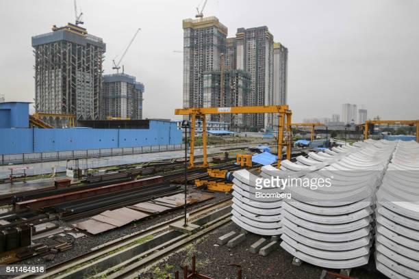 Precast concrete tunnel segments sit stacked outside at the Mumbai Metro Rail Corp casting yard in Mumbai India on Monday Aug 28 2017 The expanding...