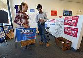 Precinct captain Allison Balden of Nevada gets campaign materials from field organizer Jonathan Mason at a campaign office for Democratic...