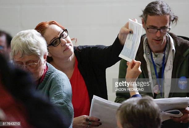 Precinct Committee Organizer Rachel Risley tally votes for candiates during Washington State Democratic Caucuses at Martin Luther King Elementary...