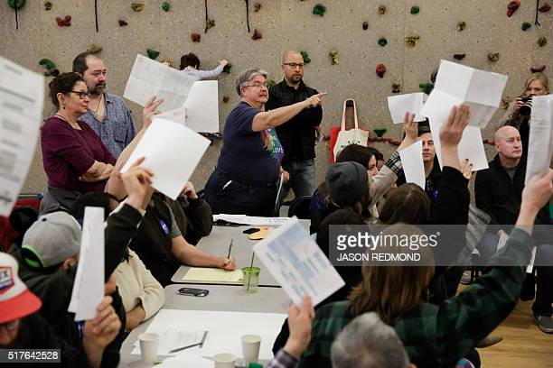 Precinct volunteer Karen Jensen takes a tally of candidate votes during Washington State Democratic Caucuses at Martin Luther King Elementary School...