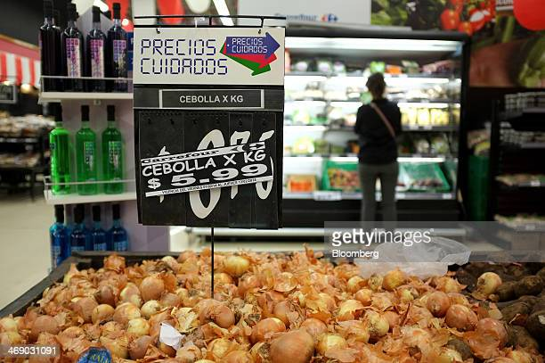 A 'precios cuidados' or 'price care' sign part of a government program to stem inflation is displayed above onions for sale at a grocery store in...